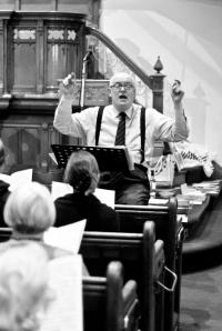 Simon conducting rehearsal